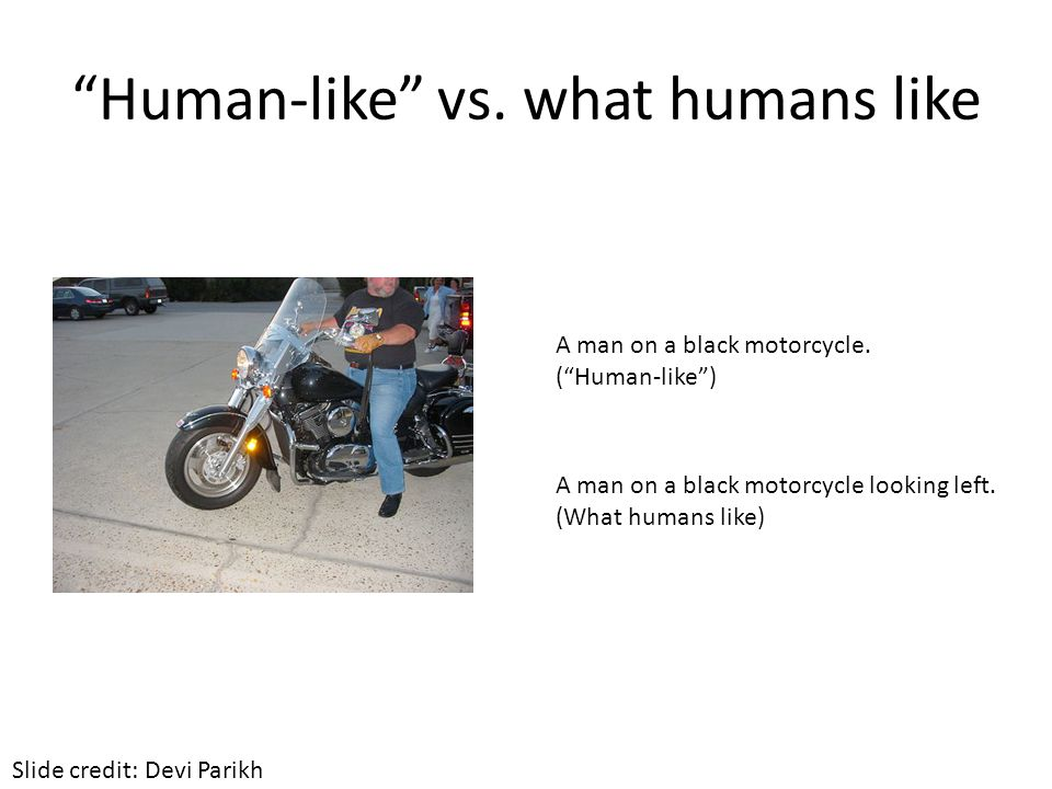 Human-like vs.what humans like A man on a black motorcycle looking left.