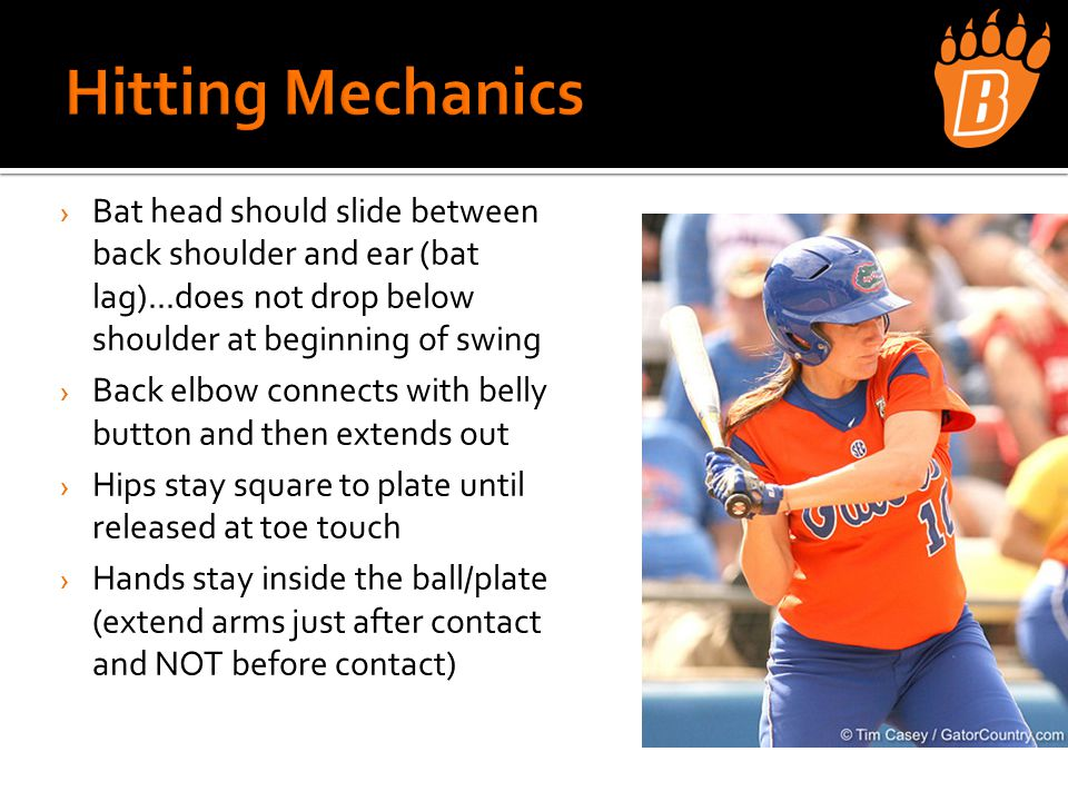 › Bat head should slide between back shoulder and ear (bat lag)...does not drop below shoulder at beginning of swing › Back elbow connects with belly button and then extends out › Hips stay square to plate until released at toe touch › Hands stay inside the ball/plate (extend arms just after contact and NOT before contact)