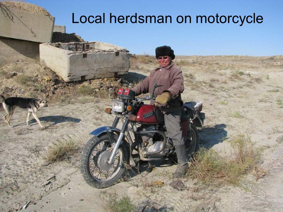 Local herdsman on motorcycle