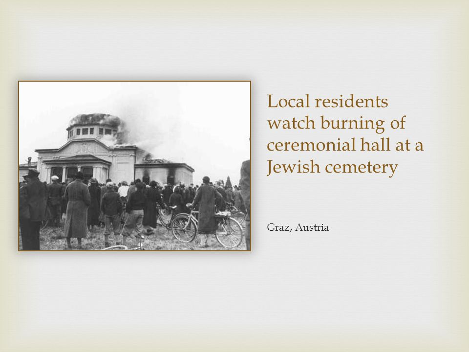 Local residents watch burning of ceremonial hall at a Jewish cemetery Graz, Austria