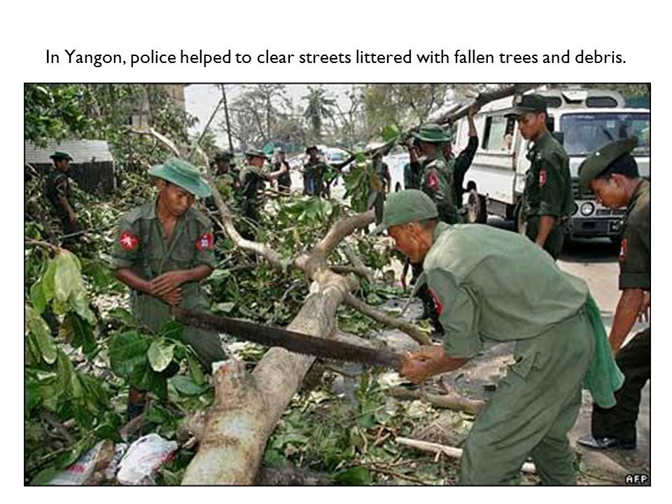 In Yangon, police helped to clear streets littered with fallen trees and debris.