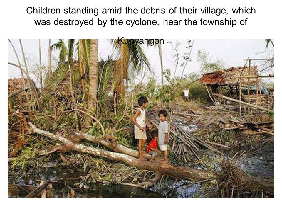 Children standing amid the debris of their village, which was destroyed by the cyclone, near the township of Kunyangon