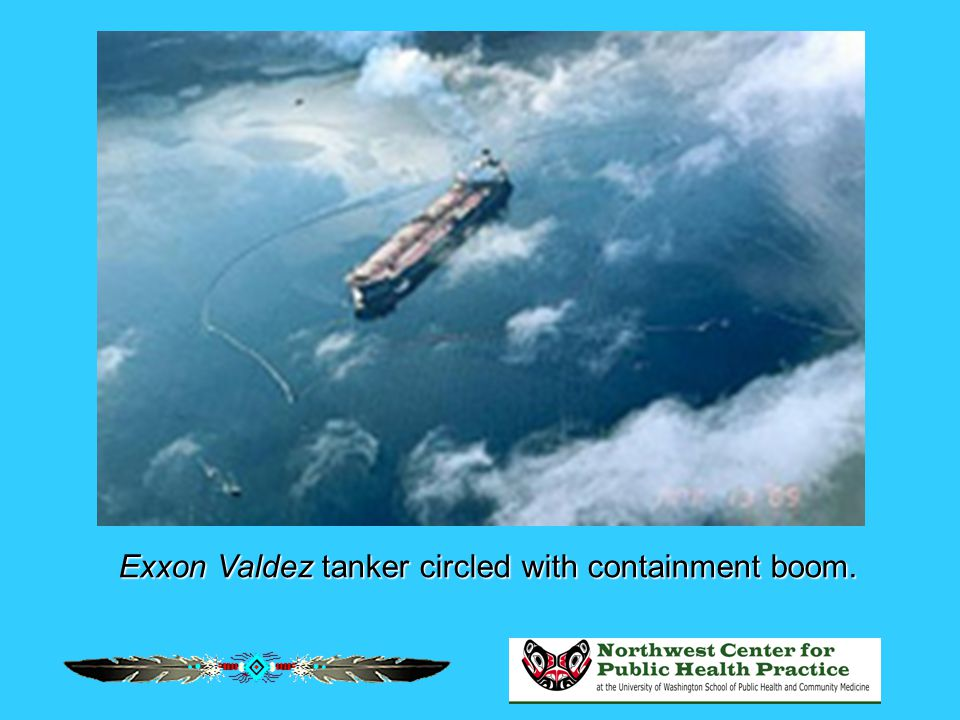 Exxon Valdez tanker circled with containment boom.
