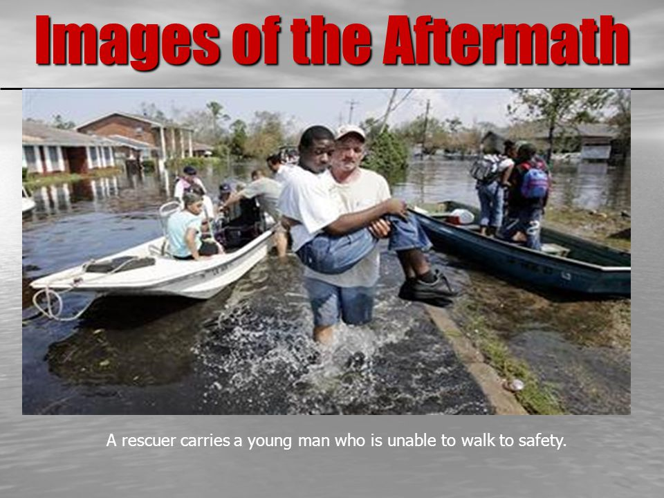 Images of the Aftermath A rescuer carries a young man who is unable to walk to safety.