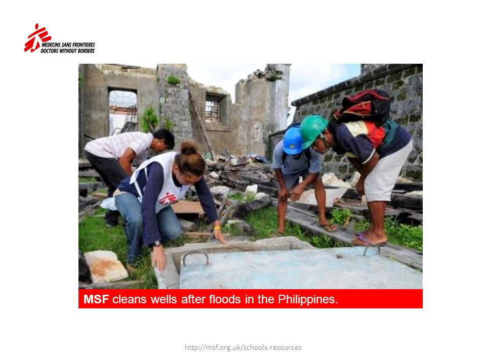 MSF cleans wells after floods in the Philippines.