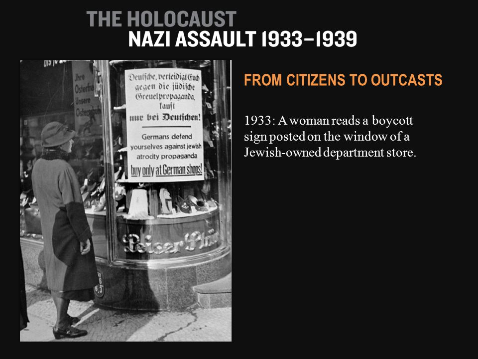 1933: A woman reads a boycott sign posted on the window of a Jewish-owned department store. FROM CITIZENS TO OUTCASTS