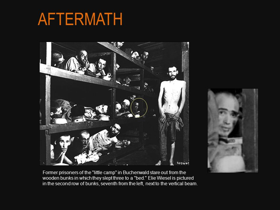 Former prisoners of the little camp in Buchenwald stare out from the wooden bunks in which they slept three to a bed. Elie Wiesel is pictured in the second row of bunks, seventh from the left, next to the vertical beam.
