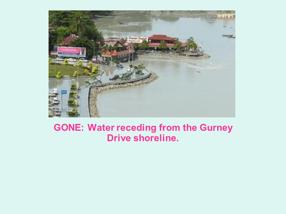 GONE: Water receding from the Gurney Drive shoreline.