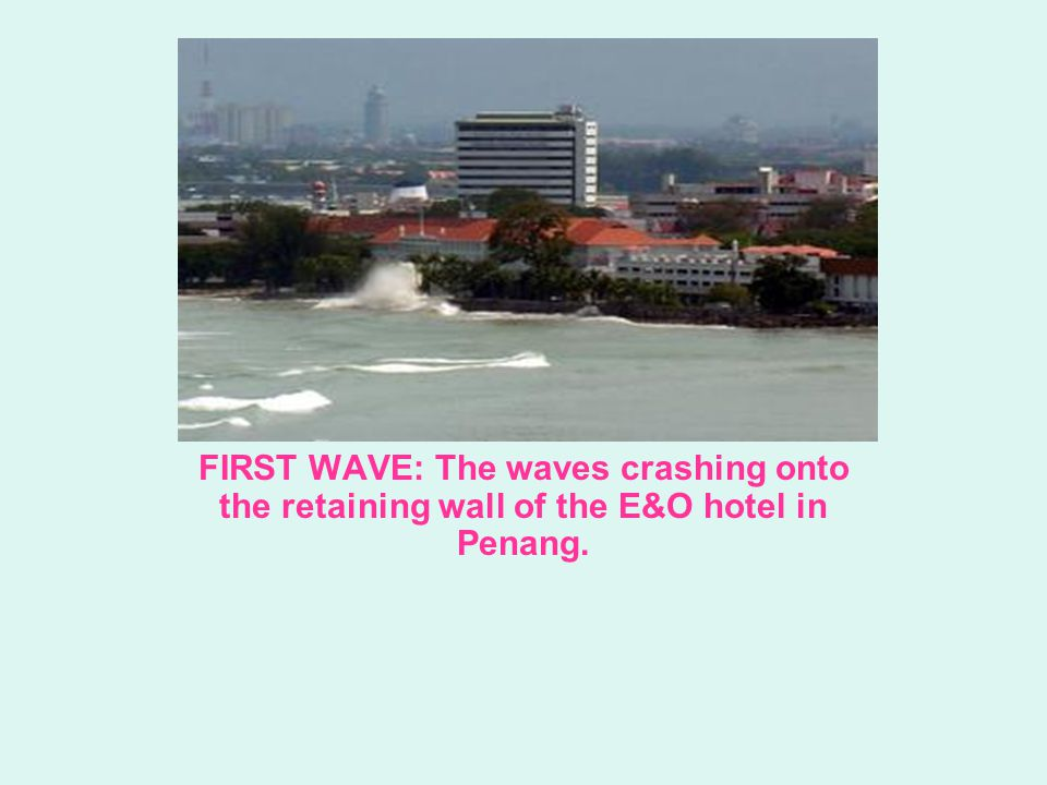 FIRST WAVE: The waves crashing onto the retaining wall of the E&O hotel in Penang.