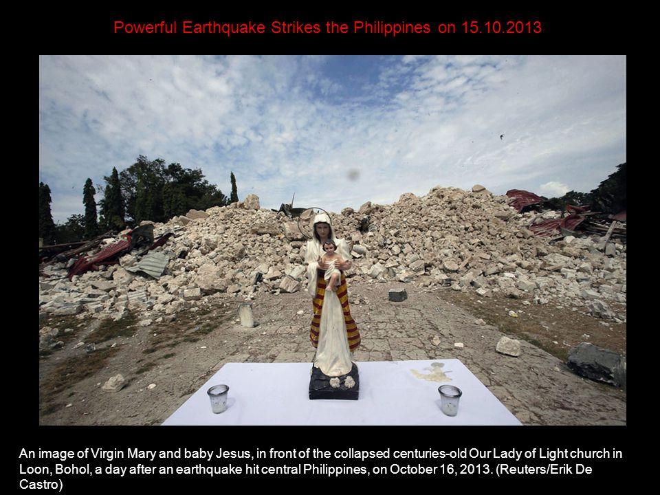 Huge boulders block a highway at Cortes township, Bohol on October 16, 2013, a day after a 7.2- magnitude quake struck.