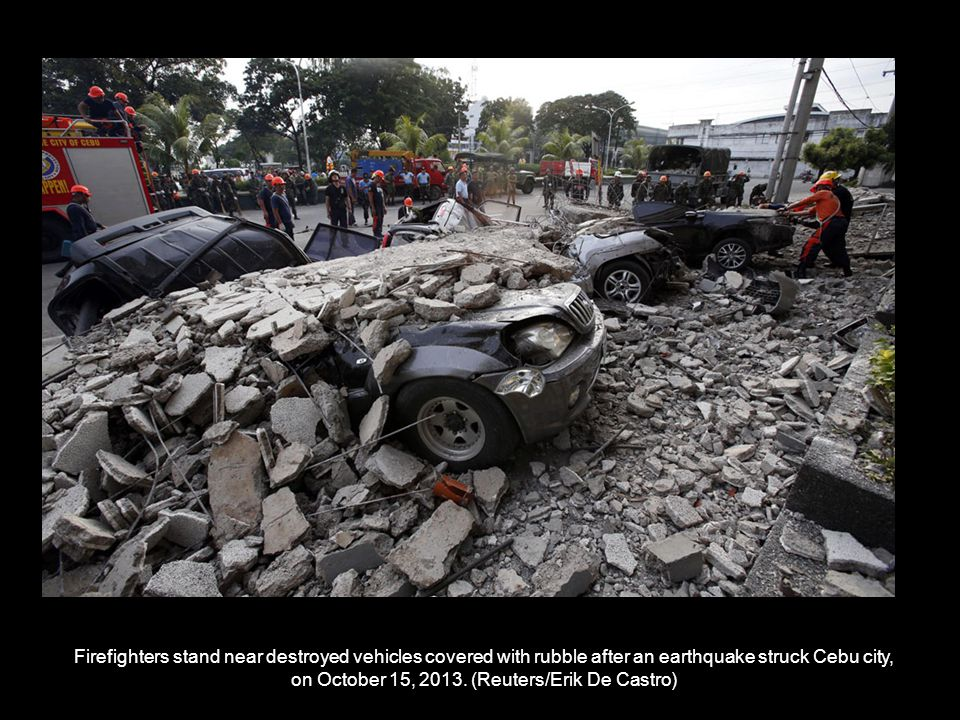 Rescue members recover the body of a vendor killed after an earthquake hit Pasil market in Cebu City, on October 15, 2013.