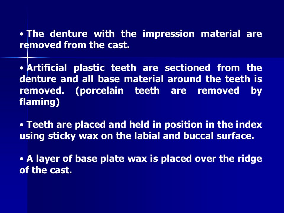 The upper part of the duplicator is closed and denture teeth are waxed to the proper thickness and contour to the cast.
