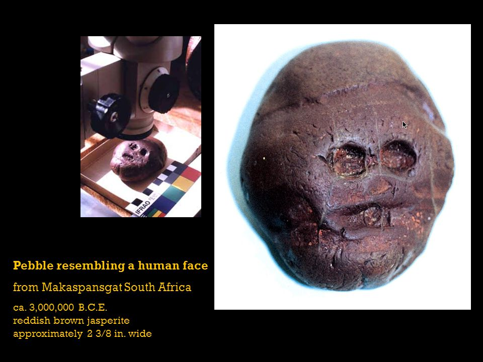 Pebble resembling a human face from Makaspansgat South Africa ca. 3,000,000 B.C.E. reddish brown jasperite approximately 2 3/8 in. wide