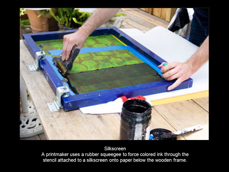 24 Silkscreen A Printmaker Uses Rubber Squeegee To Force Colored Ink Through The Stencil Attached Onto Paper Below Wooden Frame