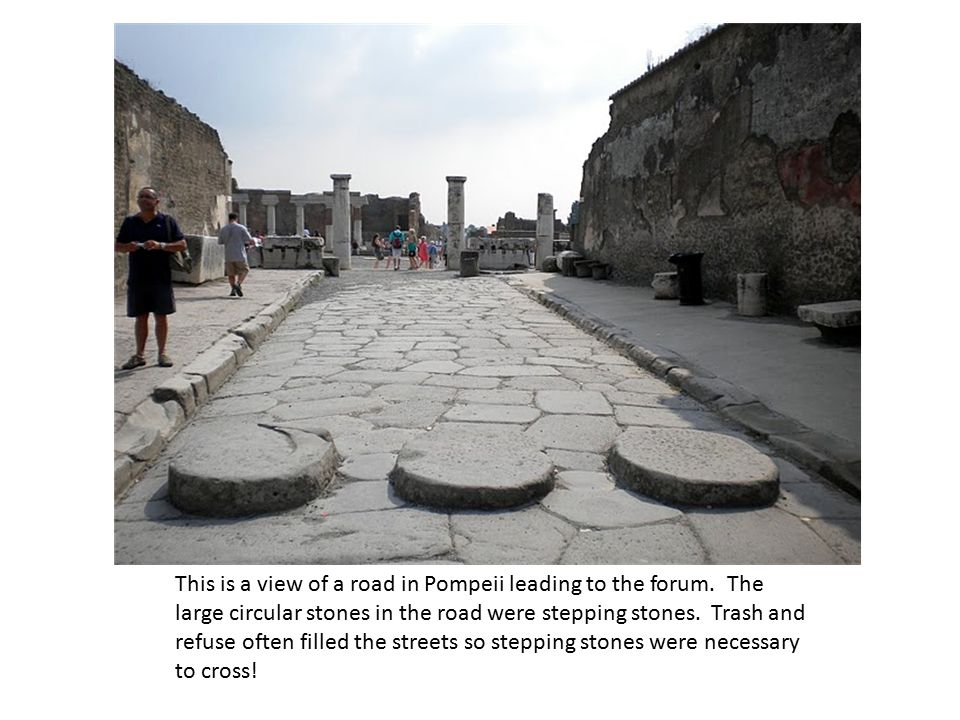 This is a view of a road in Pompeii leading to the forum.