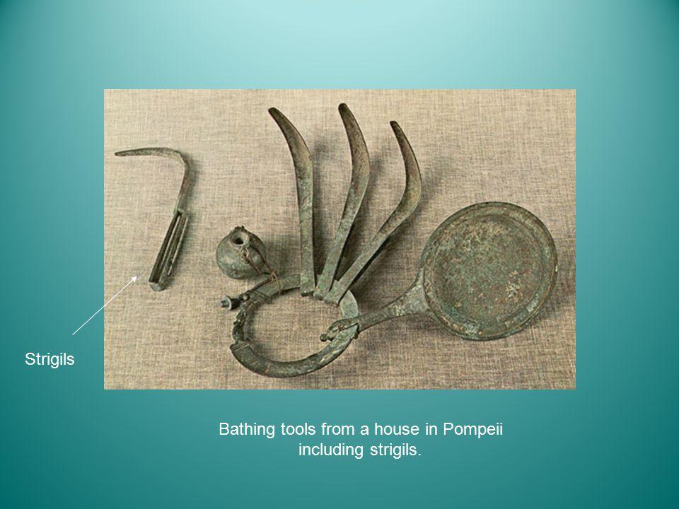 Bathing tools from a house in Pompeii including strigils. Strigils
