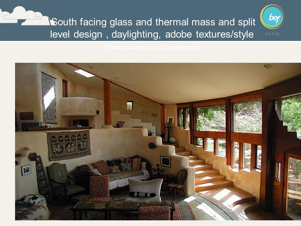 \South facing glass and thermal mass and split level design, daylighting, adobe textures/style Photo courtesy of Craig Henritzy