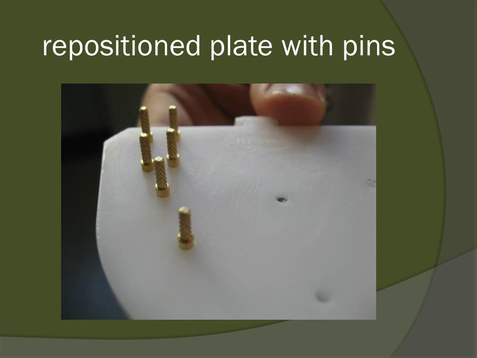 repositioned plate with pins