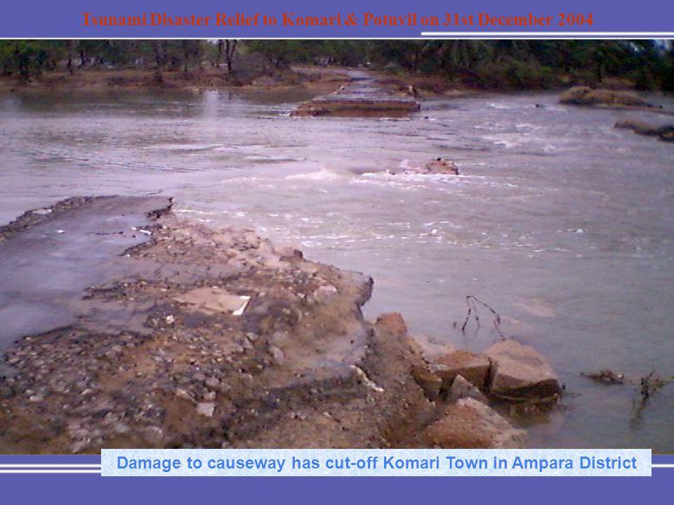 Tsunami Disaster Relief to Komari & Potuvil on 31st December 2004 Damage to causeway has cut-off Komari Town in Ampara District
