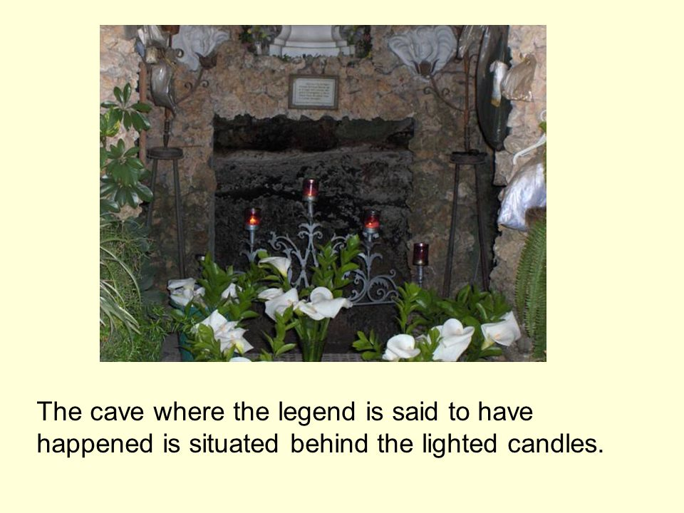 The cave where the legend is said to have happened is situated behind the lighted candles.