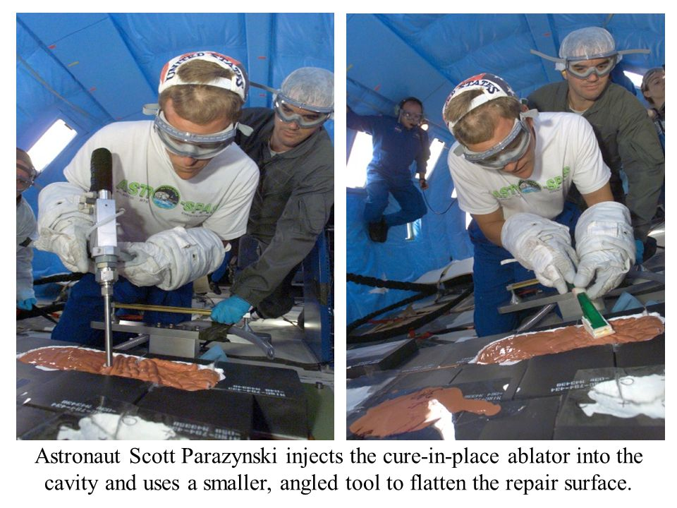 Astronaut Scott Parazynski injects the cure-in-place ablator into the cavity and uses a smaller, angled tool to flatten the repair surface.