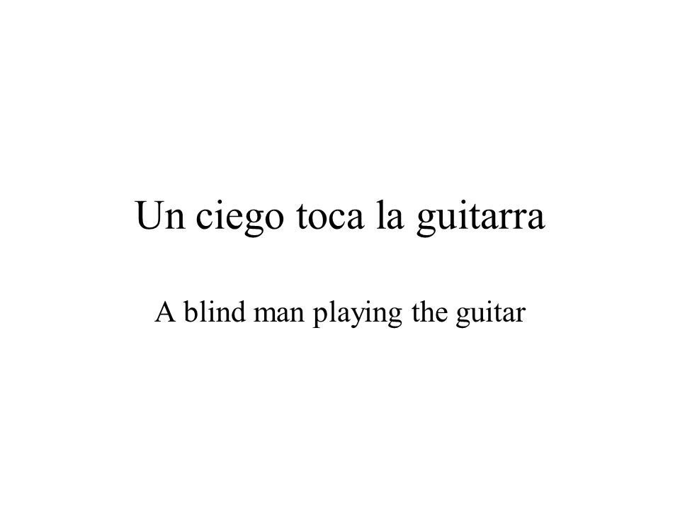 Un ciego toca la guitarra A blind man playing the guitar