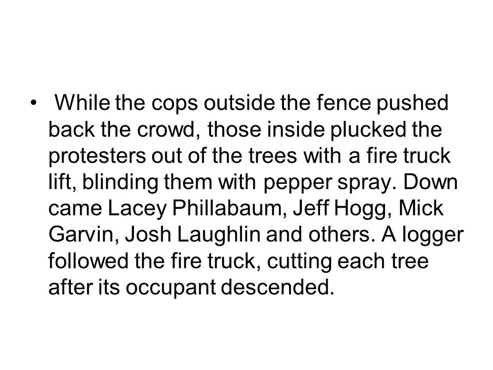 While the cops outside the fence pushed back the crowd, those inside plucked the protesters out of the trees with a fire truck lift, blinding them wit