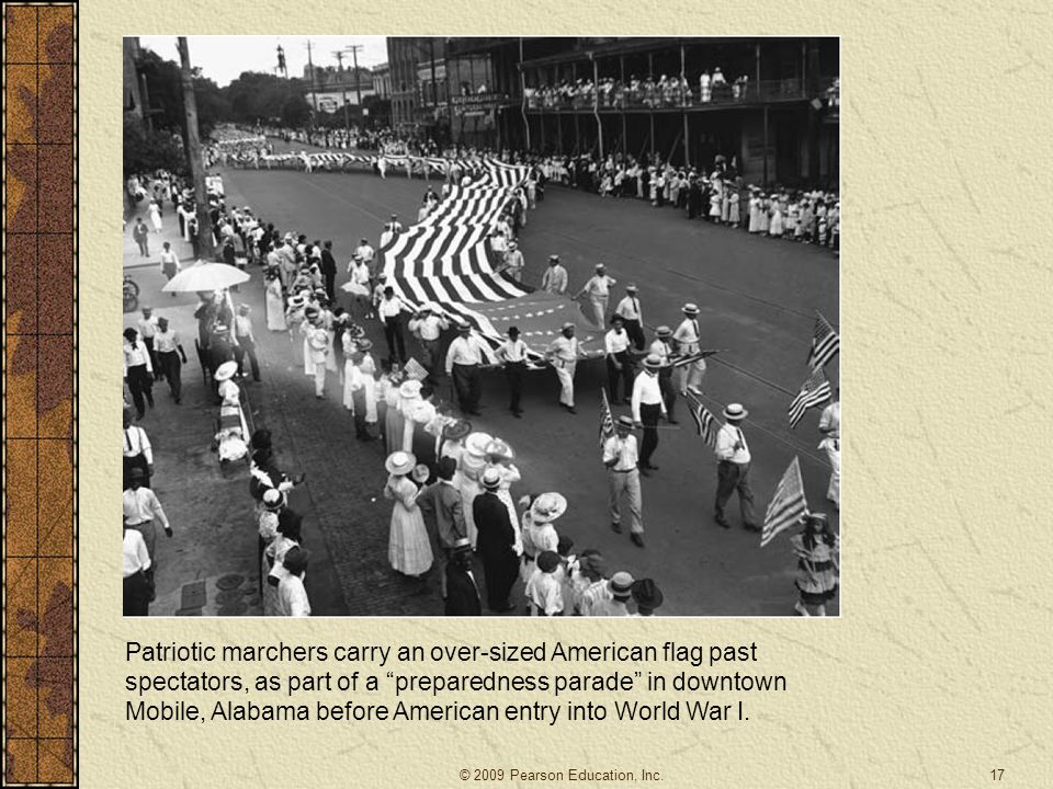 """17 Patriotic marchers carry an over-sized American flag past spectators, as part of a """"preparedness parade"""" in downtown Mobile, Alabama before America"""