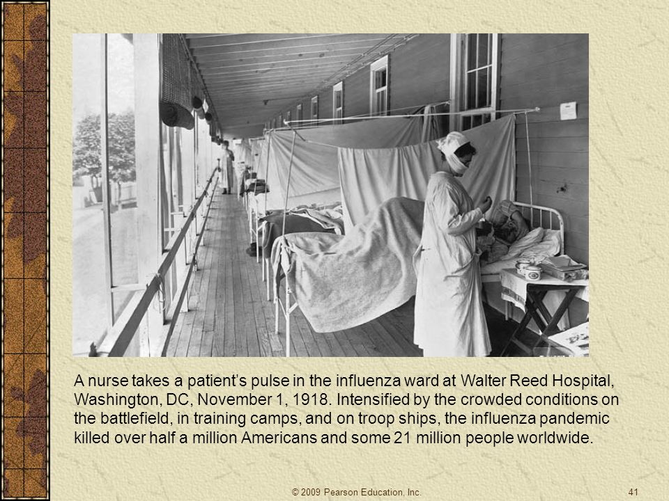 41 A nurse takes a patient's pulse in the influenza ward at Walter Reed Hospital, Washington, DC, November 1, 1918. Intensified by the crowded conditi