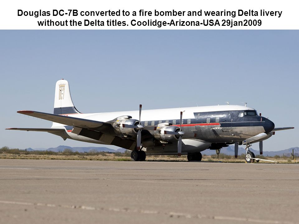 Douglas DC-7B converted to a fire bomber and wearing Delta livery without the Delta titles. Coolidge-Arizona-USA 29jan2009