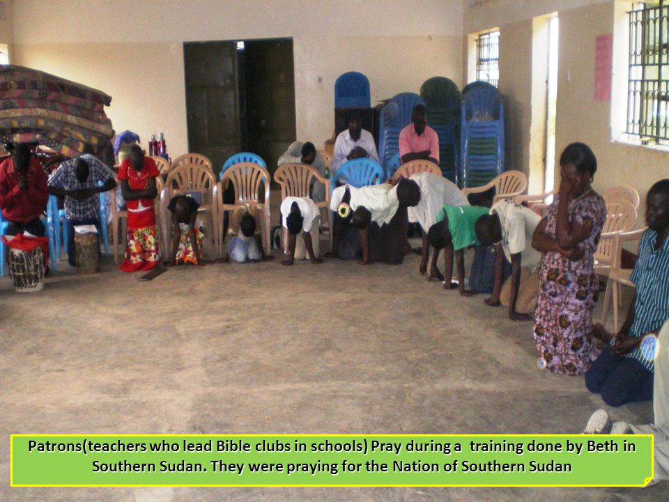 Patrons(teachers who lead Bible clubs in schools) Pray during a training done by Beth in Southern Sudan.