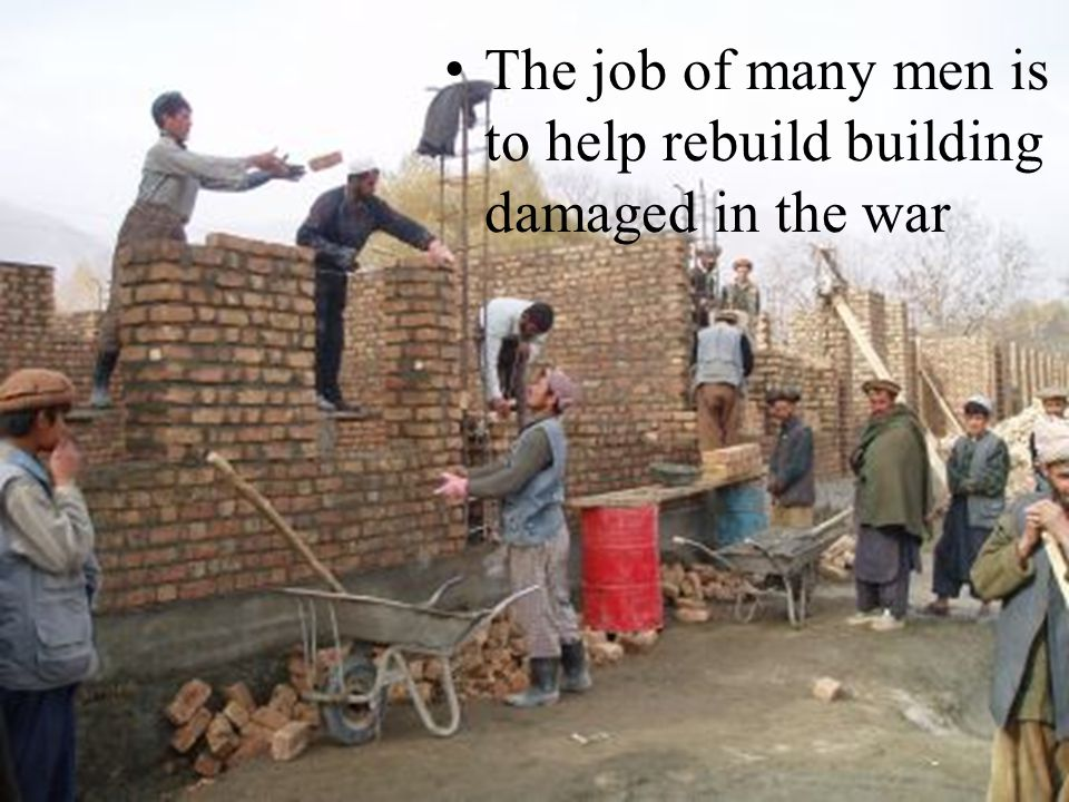 The job of many men is to help rebuild building damaged in the war