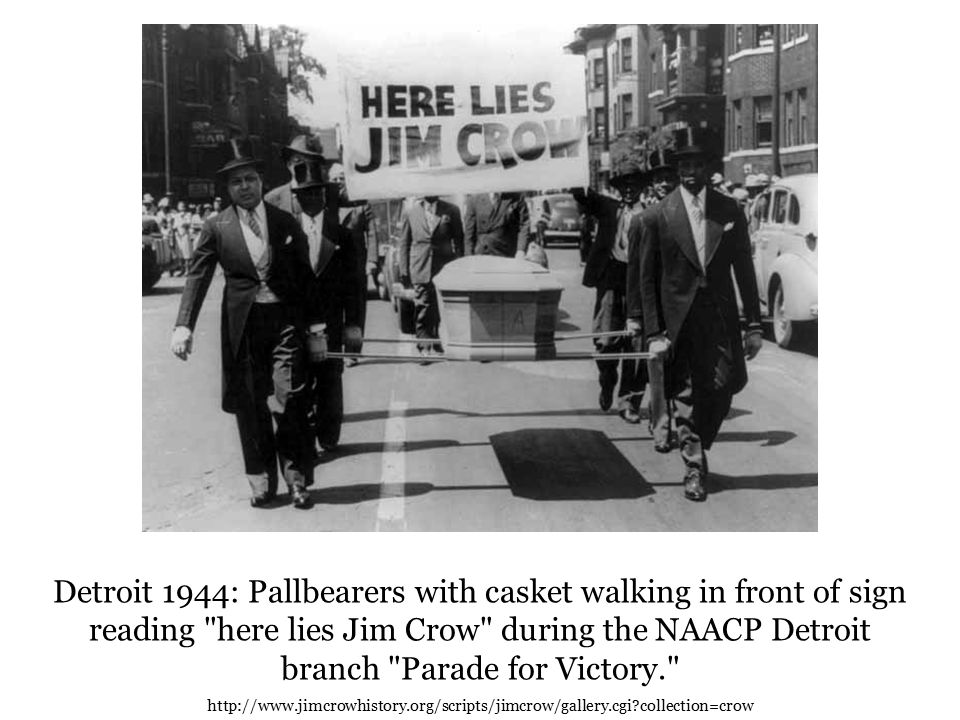 Detroit 1944: Pallbearers with casket walking in front of sign reading here lies Jim Crow during the NAACP Detroit branch Parade for Victory. http://www.jimcrowhistory.org/scripts/jimcrow/gallery.cgi collection=crow