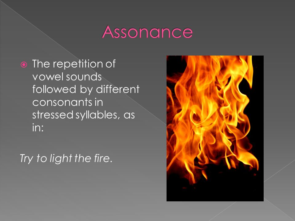  The repetition of vowel sounds followed by different consonants in stressed syllables, as in: Try to light the fire.
