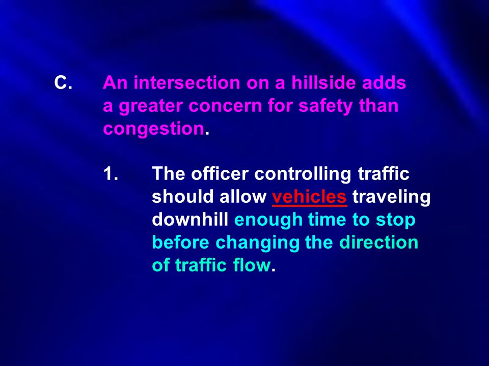 C.An intersection on a hillside adds a greater concern for safety than congestion. 1.The officer controlling traffic should allow vehicles traveling d