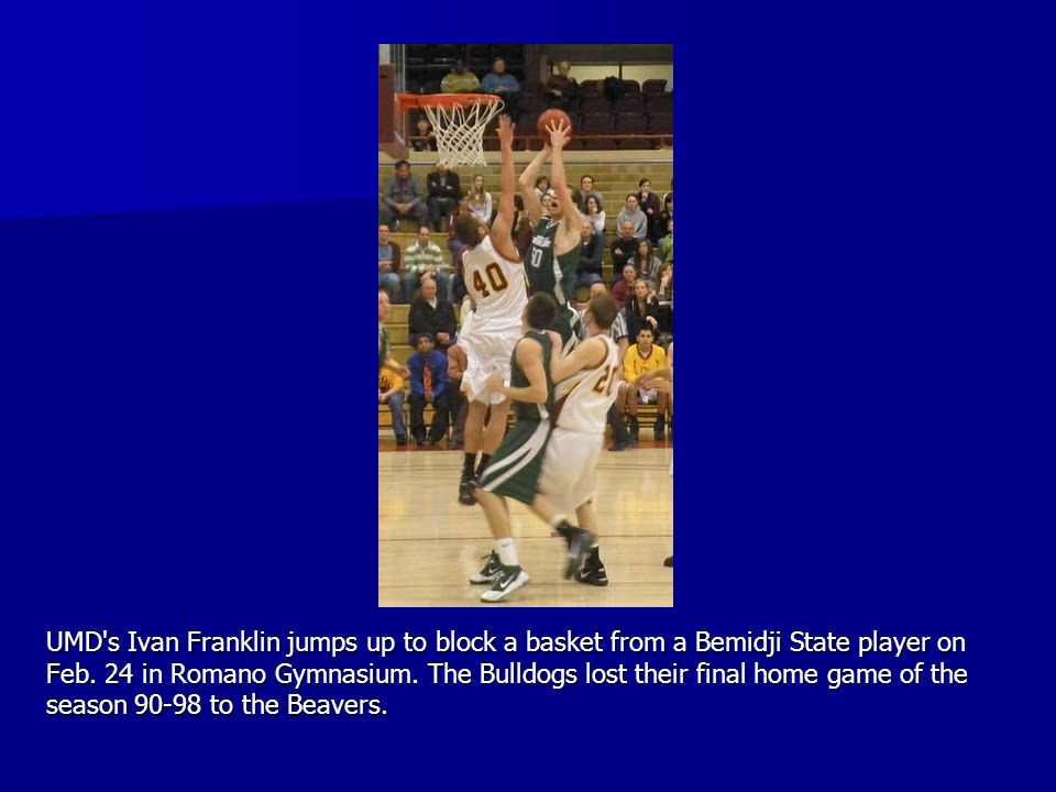 UMD's Ivan Franklin jumps up to block a basket from a Bemidji State player on Feb. 24 in Romano Gymnasium. The Bulldogs lost their final home game of
