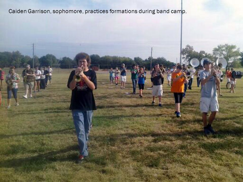 Caiden Garrison, sophomore, practices formations during band camp.