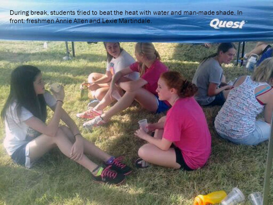 During break, students tried to beat the heat with water and man-made shade.