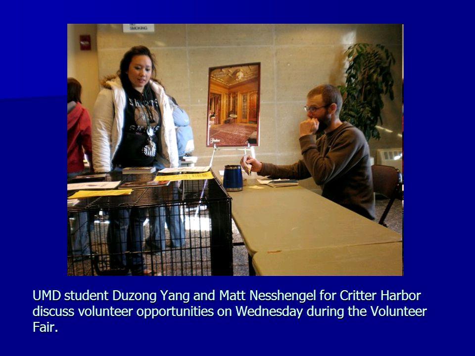 UMD student Duzong Yang and Matt Nesshengel for Critter Harbor discuss volunteer opportunities on Wednesday during the Volunteer Fair.
