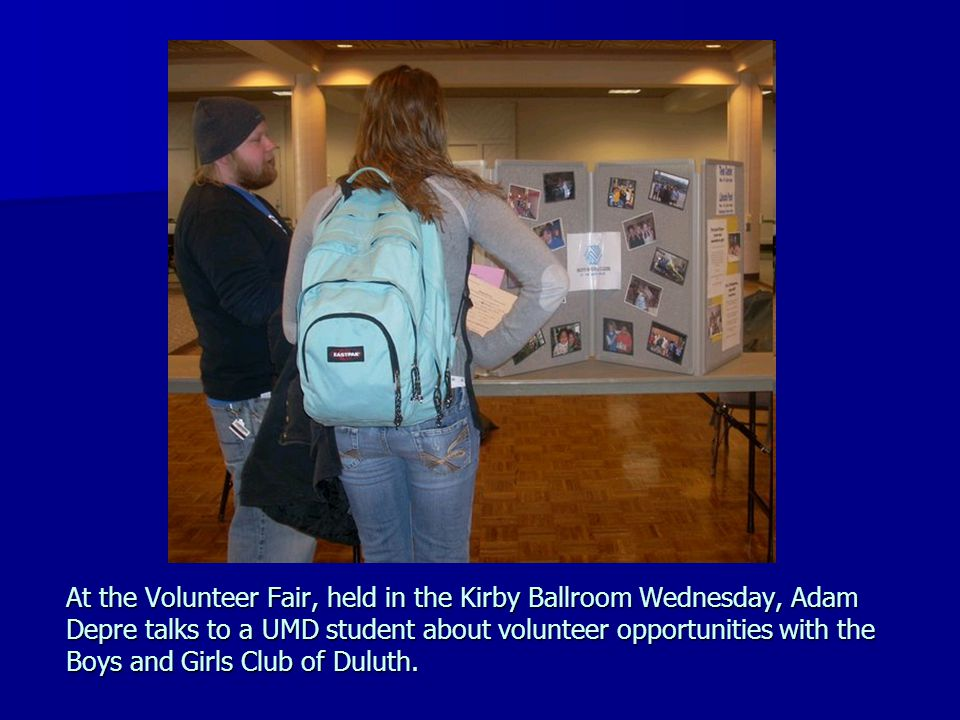 At the Volunteer Fair, held in the Kirby Ballroom Wednesday, Adam Depre talks to a UMD student about volunteer opportunities with the Boys and Girls Club of Duluth.