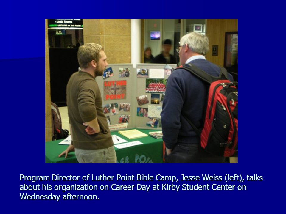 Program Director of Luther Point Bible Camp, Jesse Weiss (left), talks about his organization on Career Day at Kirby Student Center on Wednesday after
