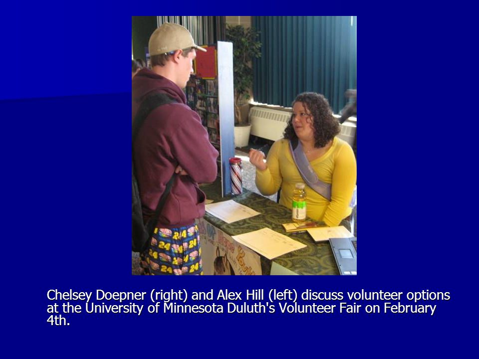 Chelsey Doepner (right) and Alex Hill (left) discuss volunteer options at the University of Minnesota Duluth s Volunteer Fair on February 4th.
