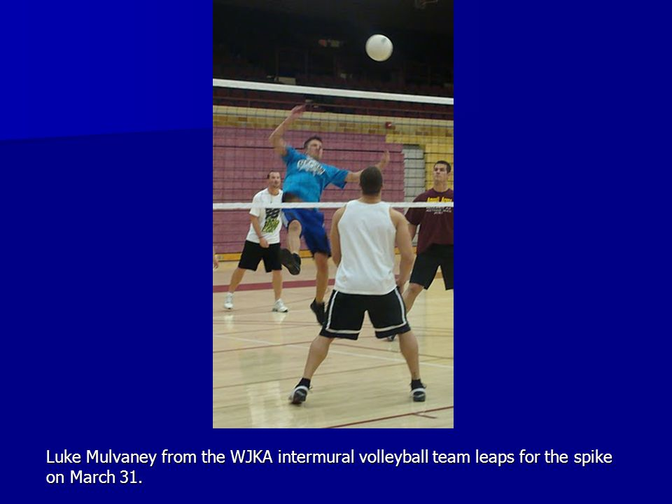 Luke Mulvaney from the WJKA intermural volleyball team leaps for the spike on March 31.