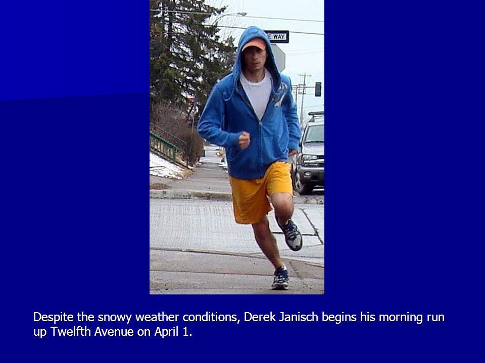 Despite the snowy weather conditions, Derek Janisch begins his morning run up Twelfth Avenue on April 1.