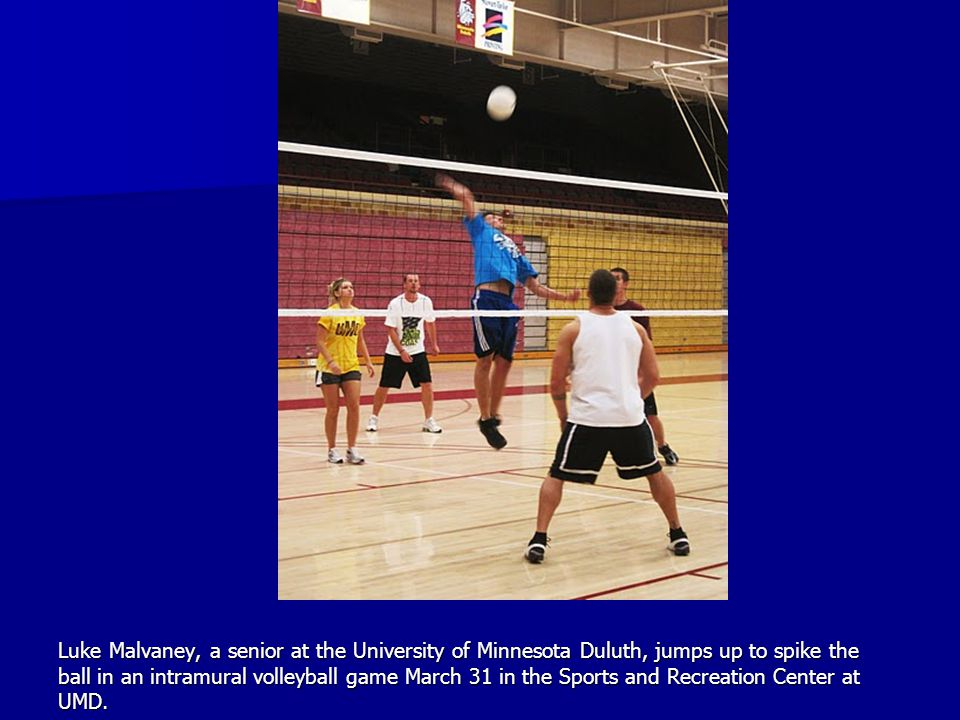 Luke Malvaney, a senior at the University of Minnesota Duluth, jumps up to spike the ball in an intramural volleyball game March 31 in the Sports and