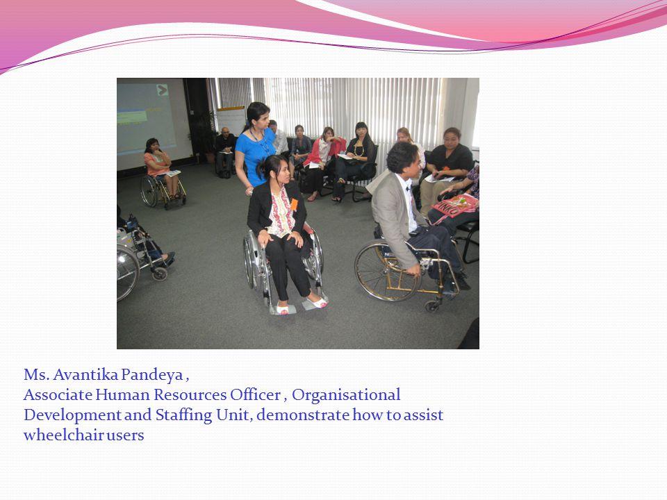 Ms. Avantika Pandeya, Associate Human Resources Officer, Organisational Development and Staffing Unit, demonstrate how to assist wheelchair users