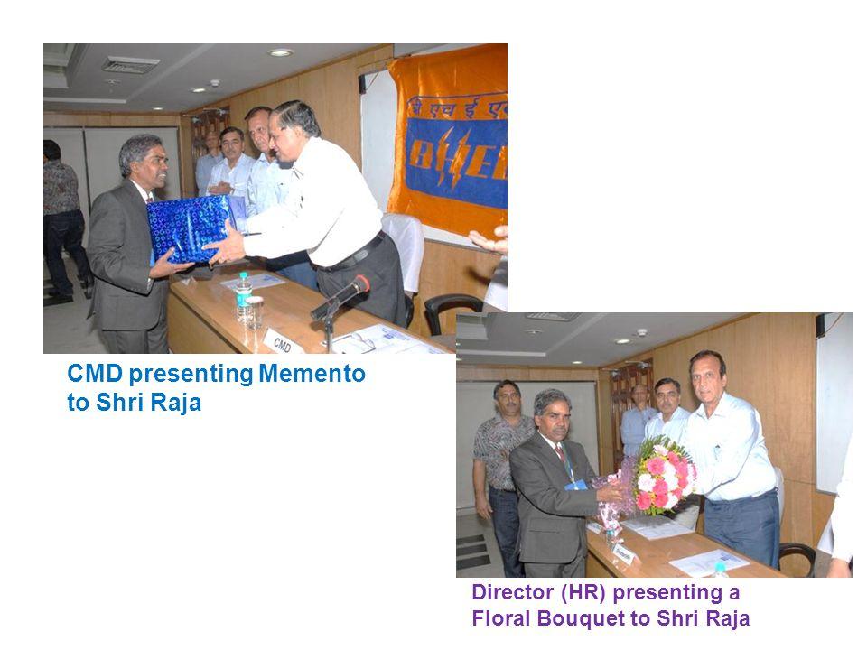 CMD presenting Memento to Shri Raja Director (HR) presenting a Floral Bouquet to Shri Raja