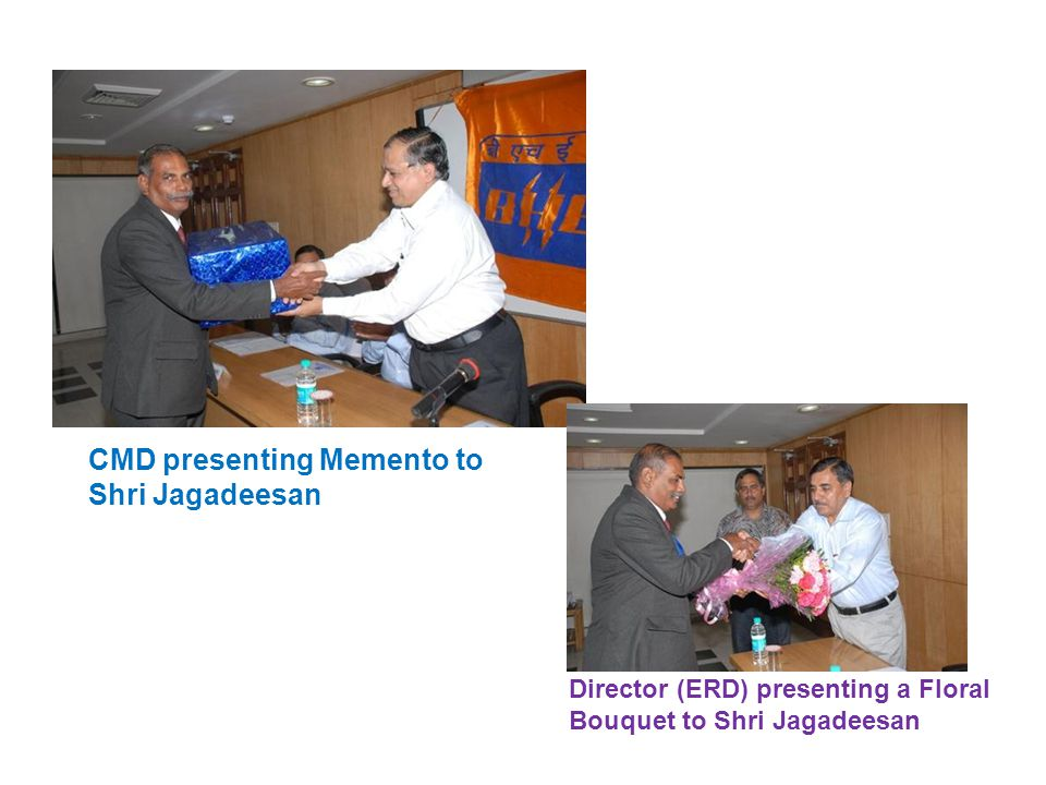 CMD presenting Memento to Shri Veerappan Director (Power) presenting a Floral Bouquet to Shri Veerappan