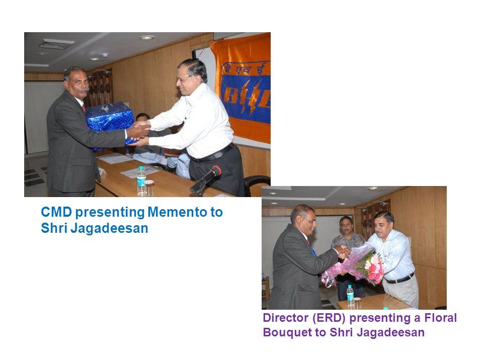 CMD presenting Memento to Shri Jagadeesan Director (ERD) presenting a Floral Bouquet to Shri Jagadeesan