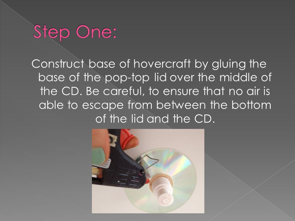 Construct base of hovercraft by gluing the base of the pop-top lid over the middle of the CD.